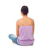 Adolescente que se sienta de detrás Foto de archivo