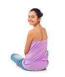 Adolescente que se sienta de detrás Imagen de archivo libre de regalías