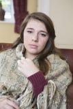 Adolescente que siente mal en casa Imagen de archivo libre de regalías