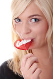 Adolescente que sostiene el lollipop rojo Foto de archivo
