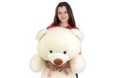 Adolescente que sostiene el oso de peluche Imagen de archivo