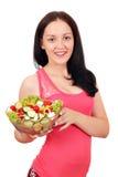 Adolescente que sostiene el plato con la ensalada Fotos de archivo