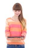 Adolescente que sostiene la tableta aislada en blanco Imagen de archivo libre de regalías