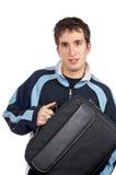 Adolescente que sostiene un bolso de la computadora portátil Imagen de archivo
