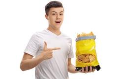 Adolescente que sostiene un bolso de microprocesadores y de señalar Foto de archivo