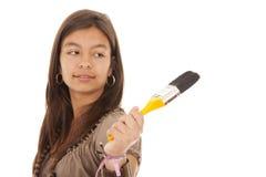 Adolescente que sostiene un cepillo Fotografía de archivo