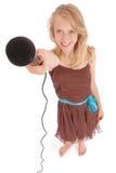 Adolescente que sostiene un micrófono en frente Imágenes de archivo libres de regalías
