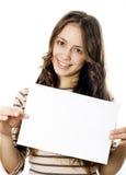 Adolescente que sostiene un papel del og del pedazo Imagen de archivo