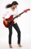 Adolescente que toca la guitarra Imágenes de archivo libres de regalías