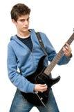 Adolescente que toca la guitarra eléctrica Foto de archivo