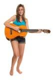 Adolescente que toca una guitarra acústica Foto de archivo