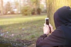 Adolescente que toma las fotografías Imagen de archivo libre de regalías