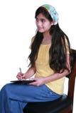 Adolescente que toma notas Imágenes de archivo libres de regalías