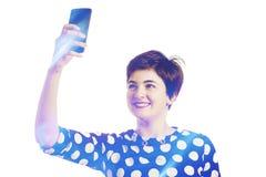 Adolescente que toma un selfie Fotografía de archivo