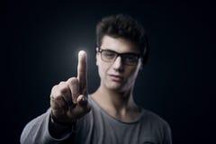 Adolescente que usa el interfaz de la pantalla táctil Fotografía de archivo libre de regalías