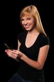 Adolescente que usa el teléfono celular Foto de archivo libre de regalías