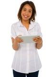 Adolescente que usa la tablilla Imagen de archivo