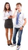 Adolescente que usa los teléfonos Fotos de archivo