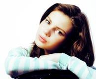Adolescente real que parece preocupado aislado en el fondo blanco Foto de archivo libre de regalías
