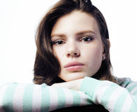Adolescente real que parece preocupado en el fondo blanco Fotografía de archivo libre de regalías