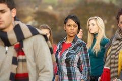 Adolescente rodeado por Friends Imagen de archivo