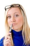 Adolescente rubio con la pluma Imagenes de archivo