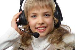 Adolescente rubio en auriculares Fotografía de archivo