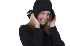 Adolescente rubio en sombrero negro Foto de archivo libre de regalías