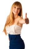 Adolescente rubio hermoso que muestra el pulgar para arriba como muestra del allr Fotografía de archivo libre de regalías