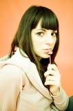 Adolescente secreto com Lollipop Imagens de Stock Royalty Free