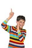 Adolescente secreto que aponta acima e que sorri Foto de Stock