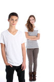 Adolescente serio che propone con la sua sorella Fotografia Stock Libera da Diritti