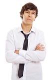 Adolescente serio con los brazos cruzados Imagen de archivo