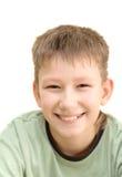 Adolescente sonriente. Aislado en blanco Imagen de archivo