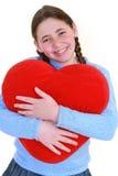 Adolescente sonriente con el haert rojo Imagen de archivo