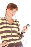 Adolescente sonriente con el teléfono celular Imagen de archivo libre de regalías
