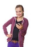 Adolescente sonriente con el teléfono móvil, aislado en blanco Foto de archivo libre de regalías