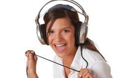 Adolescente sonriente con los auriculares Imagen de archivo libre de regalías