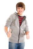 Adolescente sonriente con los pulgares para arriba Foto de archivo