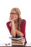 Adolescente sonriente de la colegiala con los libros en vidrios Imágenes de archivo libres de regalías