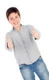Adolescente sonriente de trece que dice muy bien Imágenes de archivo libres de regalías