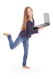 Adolescente sonriente del estudiante con el ordenador portátil Fotografía de archivo libre de regalías
