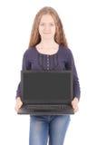 Adolescente sonriente del estudiante con el ordenador portátil Fotos de archivo