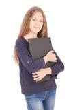 Adolescente sonriente del estudiante con el ordenador portátil Fotografía de archivo