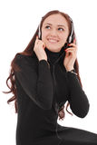 Adolescente sonriente del retrato con los auriculares Fotografía de archivo