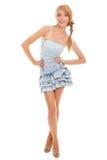 Adolescente sonriente en alineada azul Imagen de archivo libre de regalías