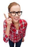 Adolescente sonriente en lentes con el finger para arriba Imagen de archivo libre de regalías