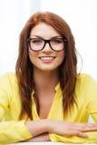Adolescente sonriente en lentes en casa Imágenes de archivo libres de regalías