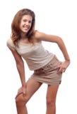 Adolescente sonriente hermoso en falda corta Imagen de archivo libre de regalías