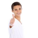 Adolescente sonriente que da los pulgares para arriba Fotos de archivo libres de regalías